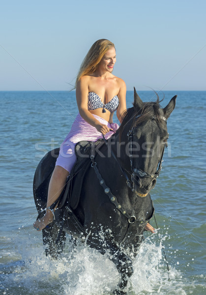 horsewoman and horse in the sea Stock photo © cynoclub