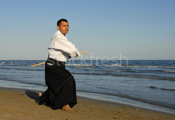 Aikido strand jonge man opleiding man zee Stockfoto © cynoclub