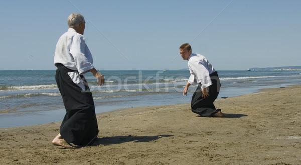 Eğitim aikido plaj iki yetişkin adam Stok fotoğraf © cynoclub