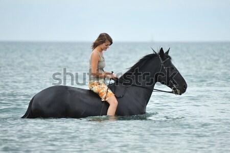 海 黒 種馬 若い女性 ビーチ ストックフォト © cynoclub