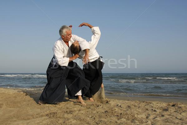 Opleiding aikido strand twee volwassenen man Stockfoto © cynoclub