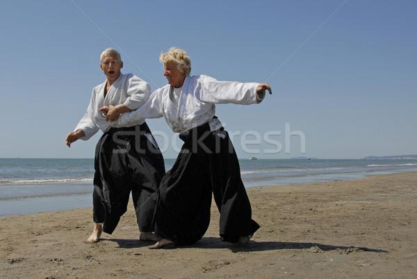 Eğitim aikido plaj iki yetişkin yaşlılar Stok fotoğraf © cynoclub