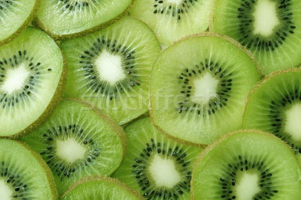 Stock photo: Backlit Kiwi Slice