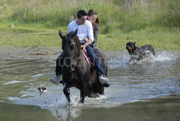 Equitación Pareja río perros amantes negro Foto stock © cynoclub