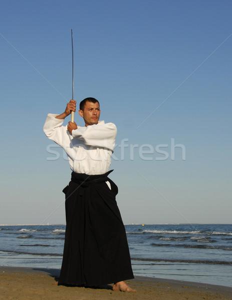 Genç eğitim aikido plaj adam deniz Stok fotoğraf © cynoclub