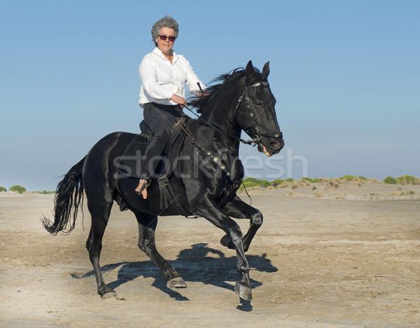 At kadın siyah aygır plaj spor Stok fotoğraf © cynoclub