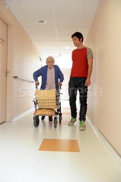 male nurse and senior woman with walking frame Stock photo © cynoclub