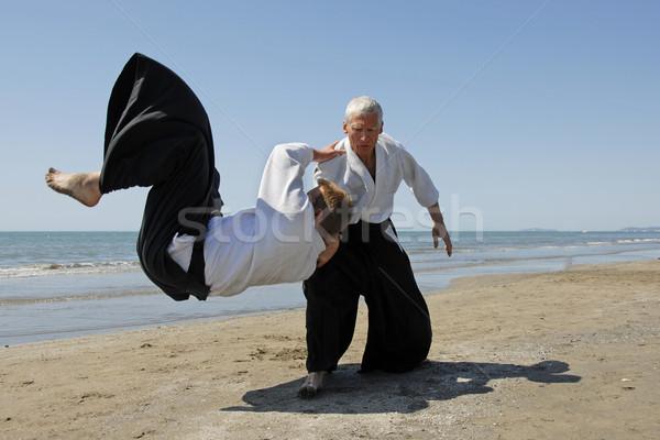Aikido twee volwassenen opleiding strand man Stockfoto © cynoclub