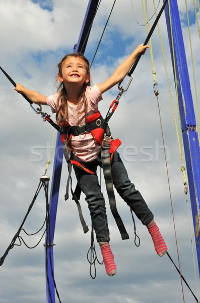 Springen meisje trampoline meisje kind haren Stockfoto © cynoclub