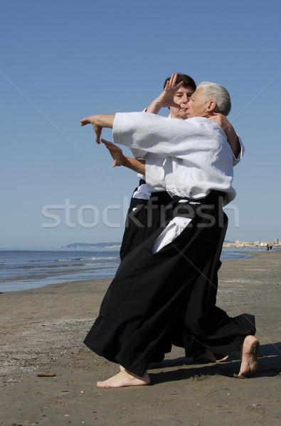 Opleiding aikido twee volwassenen strand man Stockfoto © cynoclub