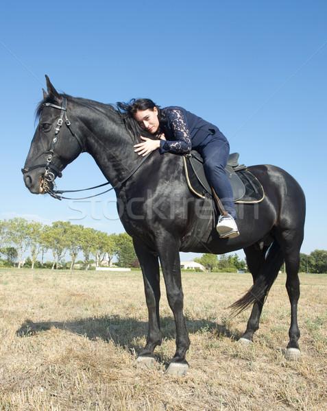 Jóvenes equitación nina joven negro semental Foto stock © cynoclub