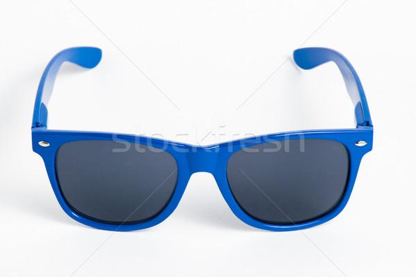 Bleu plastique lunettes de soleil isolé blanche enfants Photo stock © cypher0x