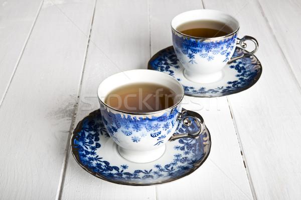 Bleu blanche table en bois fleurs feuille Photo stock © cypher0x