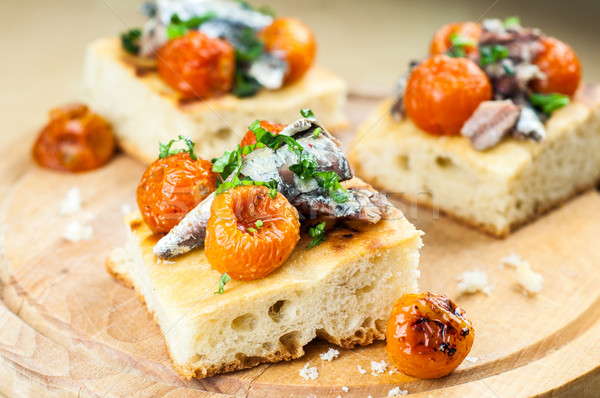 Delicious focaccia with sardines and cherry tomatoes Stock photo © cypher0x