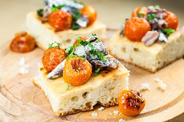 Finom koktélparadicsom fa hal pizza asztal Stock fotó © cypher0x