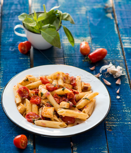 Colorful penne pasta with tomatoes and basil Stock photo © cypher0x