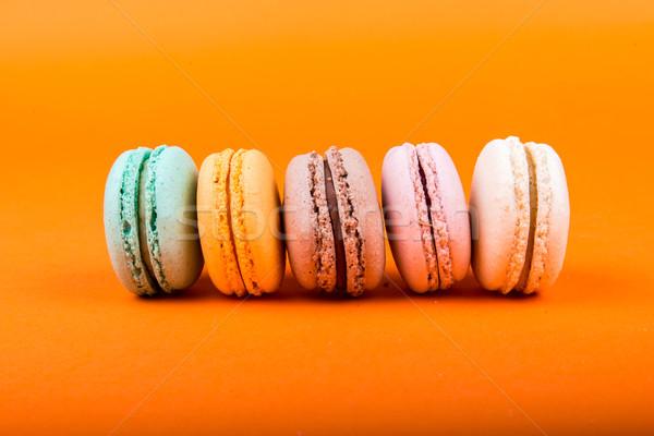 Macarons orange isolé alimentaire bleu Photo stock © cypher0x