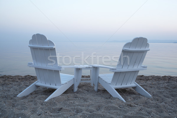 Empty wooden deck chairs on a beach Stock photo © d13