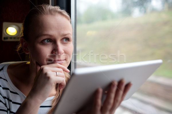 Smiling young woman traveling by train Stock photo © d13
