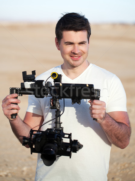 Smiling man with steadicam equipment outdoor Stock photo © d13