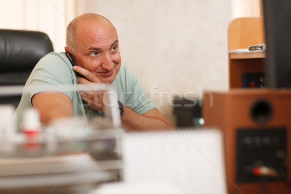Middle-aged businessman on the phone Stock photo © d13