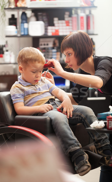 Little boy at the hairdresser Stock photo © d13