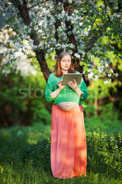 Stock photo: She having peaceful time with pad outdoor
