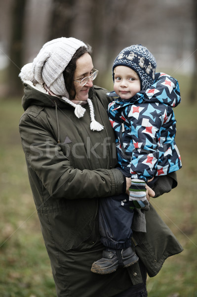 Woman holding her small son Stock photo © d13