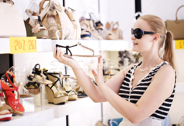 Young woman in the shoe shop Stock photo © d13