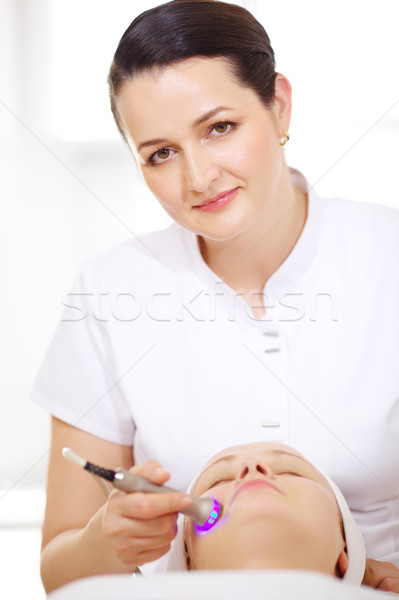 Cosmetician making lifting procedure Stock photo © d13