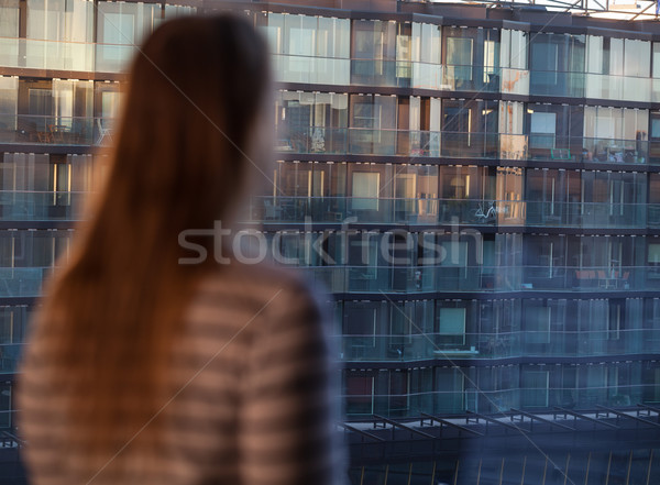Woman looking at an apartment block Stock photo © d13