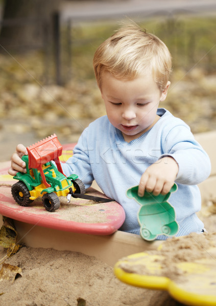 Boy playing with toy outdoor. Stock photo © d13