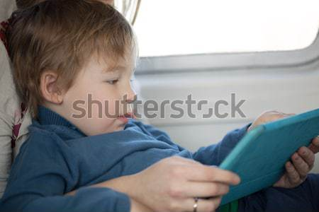Stock photo: Woman holding newborn baby sitting in the car