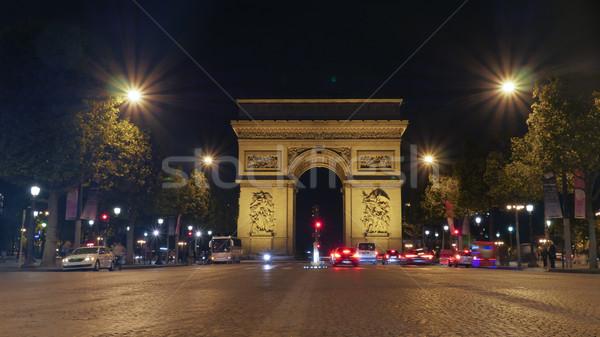 Arc de Triomphe, Paris illuminated at night Stock photo © d13