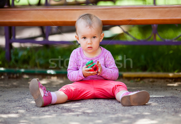 Small baby playing with toy Stock photo © d13