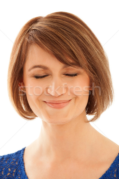 Close-up of adult woman with eyes closed Stock photo © d13