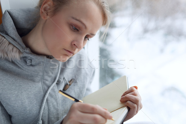 Young girl writing in her journal. Stock photo © d13