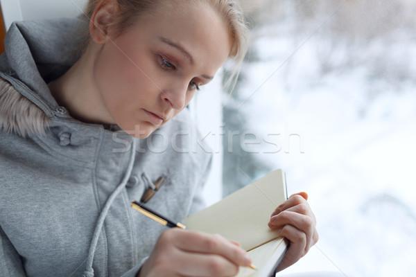 Fiatal lány ír napló ül nagy ablak Stock fotó © d13
