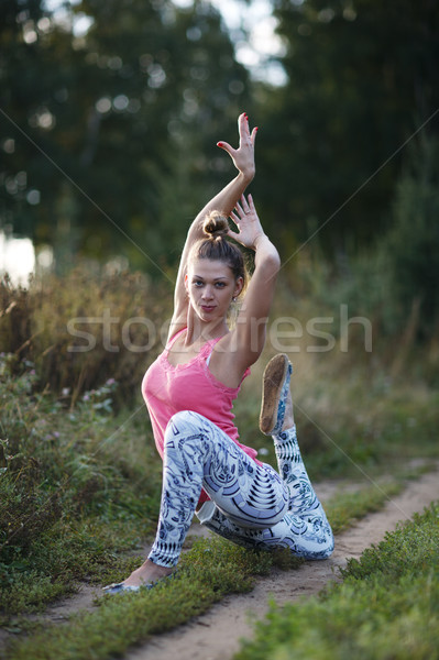 Supple graceful young woman exercising outdoors Stock photo © d13