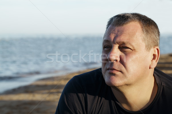 Handsome middle-aged man thinking at the beach Stock photo © d13