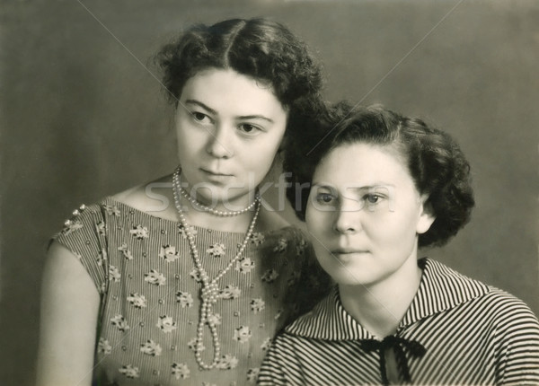 Vintage portrait of two attractive women Stock photo © d13