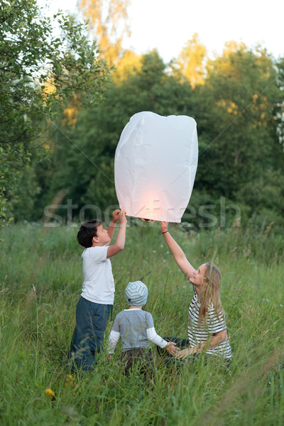 Family of three flying paper lantern outdoor Stock photo © d13