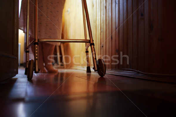Senior woman using walker at home Stock photo © d13