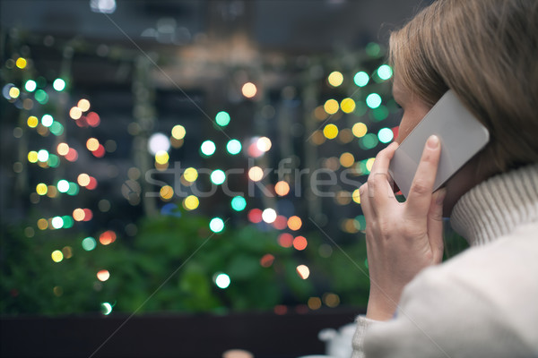 Woman in cafe talking on the phone Stock photo © d13