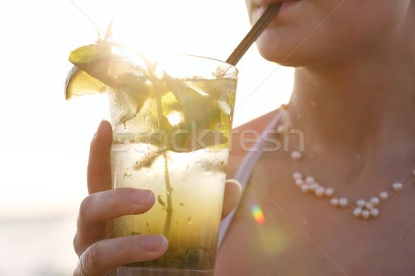 Woman enjoying a tropical mojito cocktail Stock photo © d13
