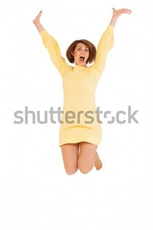 Volwassen vrouw Geel jurk springen mooie Stockfoto © d13