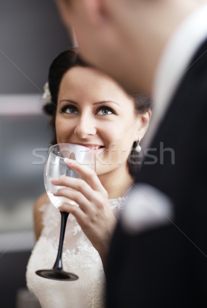 Elegant woman drinking wine at a function Stock photo © d13