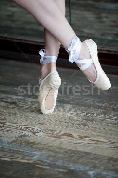 Dancing feet in ballet shoes on wooden floor Stock photo © d13