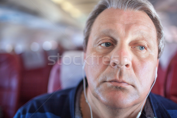 Man listening to music in the airplane Stock photo © d13
