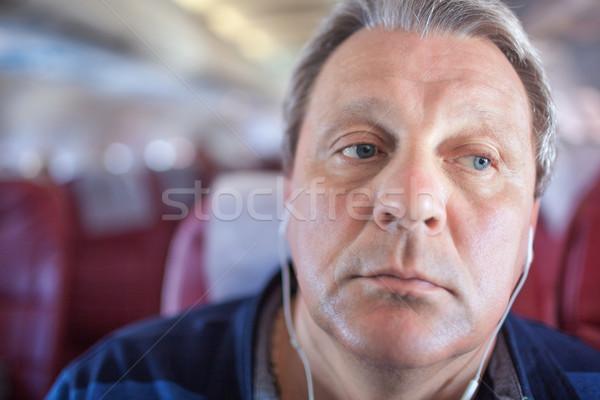 Homem ouvir música avião tiro homem maduro Foto stock © d13
